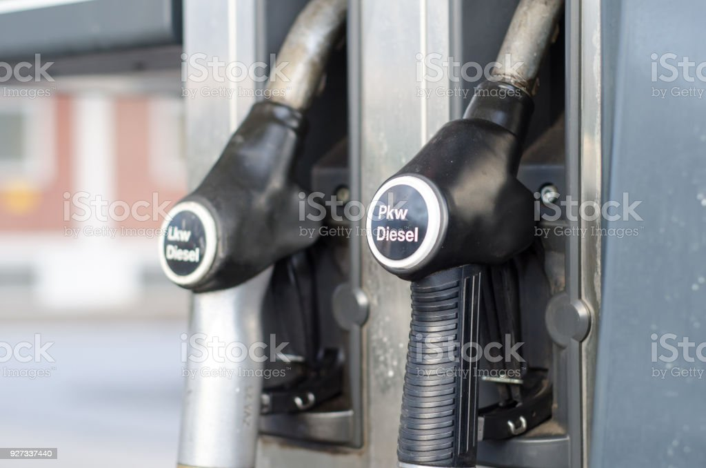 Filling Lkw Pkw diesel in station stock photo