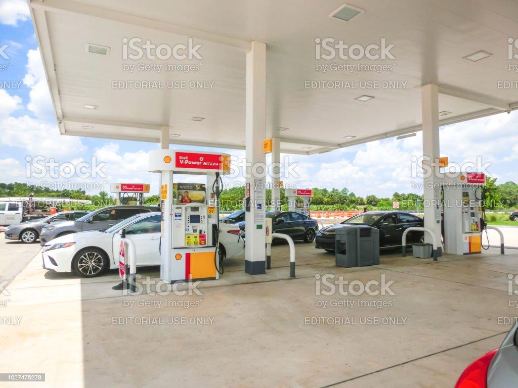 Orlando, USA - May 8, 2018: Filling nozzles at a Shell gas station stock photo