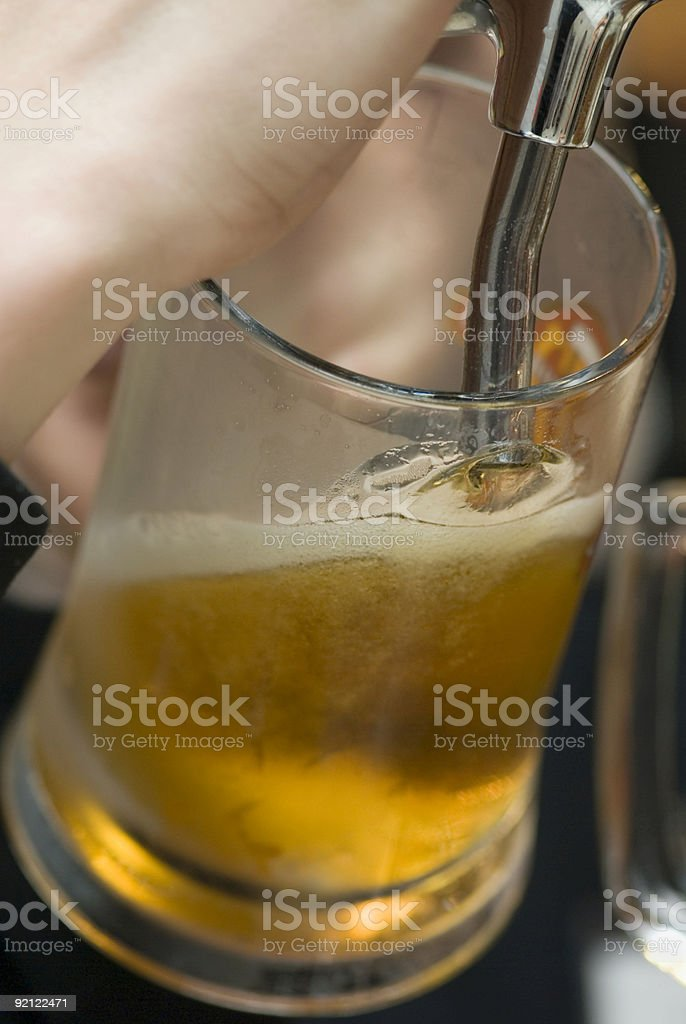 Filling of beer mug royalty-free stock photo