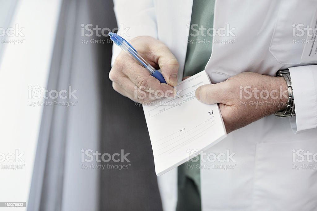 Filling out a doctor's prescription stock photo