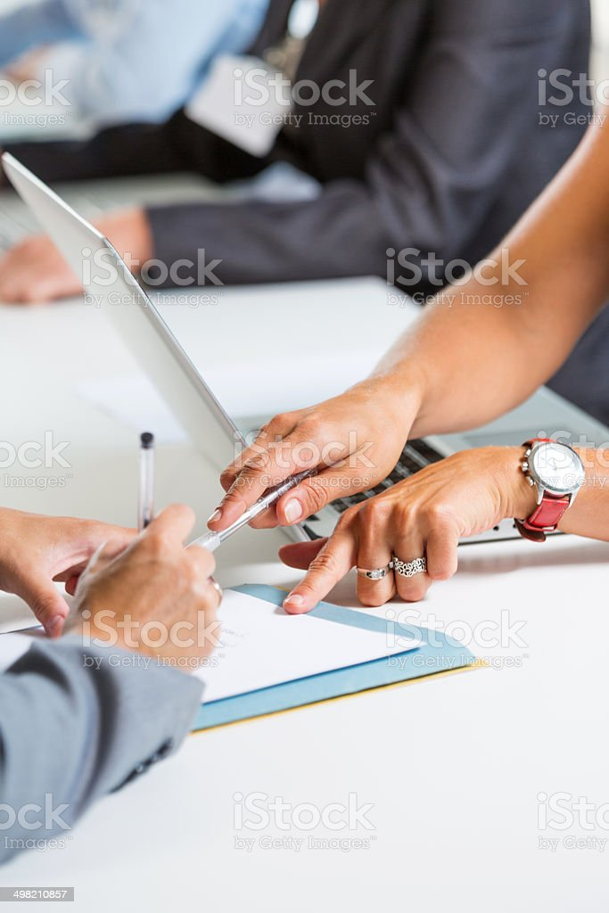Filling out a form Businesswomen filling out a form. Close up of female hands. Adult Stock Photo
