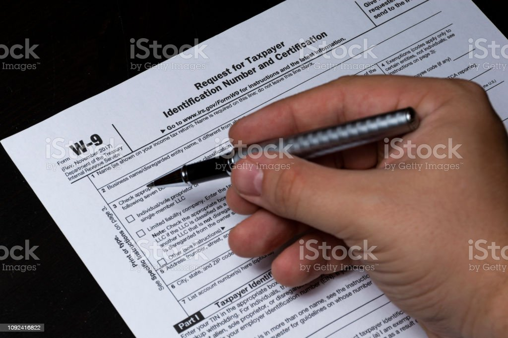 Filling out a W-9 stock photo
