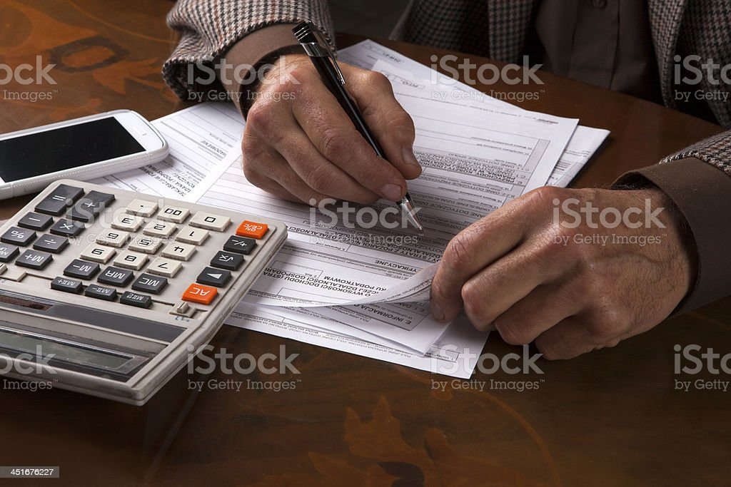 Filling out forms stock photo