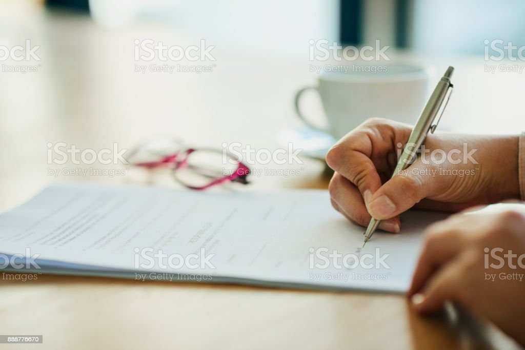 Filling out some forms stock photo