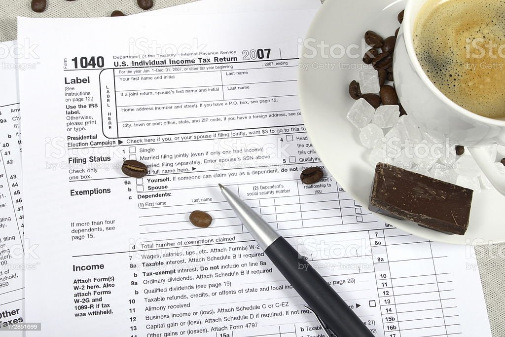 Filling out Tax Form royalty-free stock photo