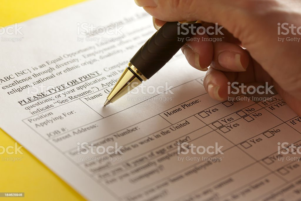 Filling out the application stock photo