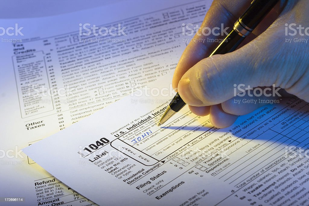 Filling out U S Income Tax Hz stock photo