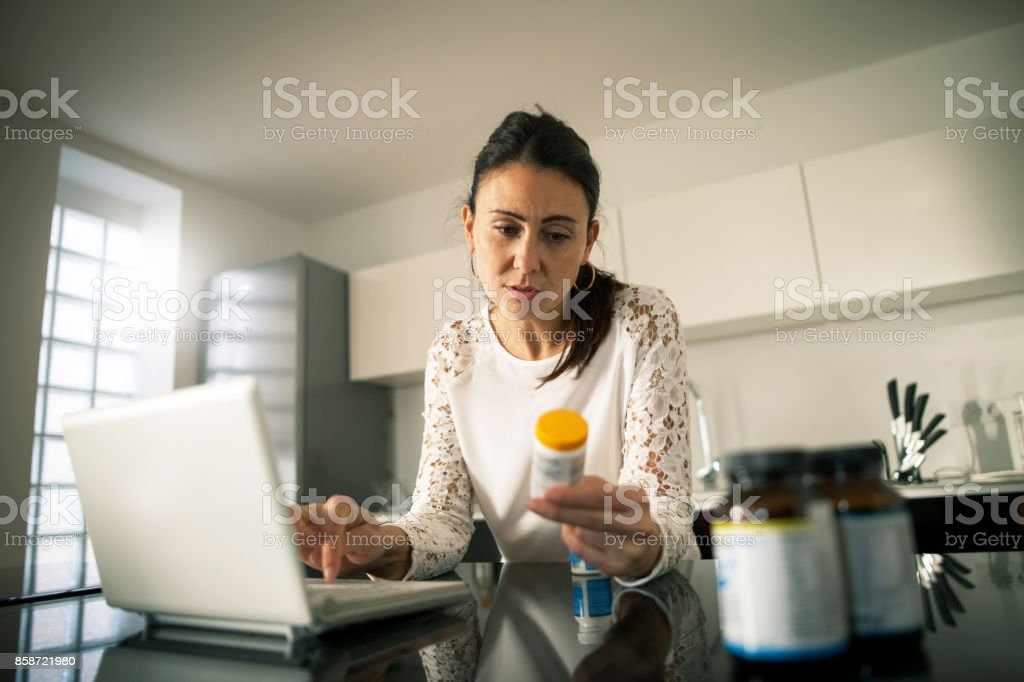 Filling prescription online stock photo