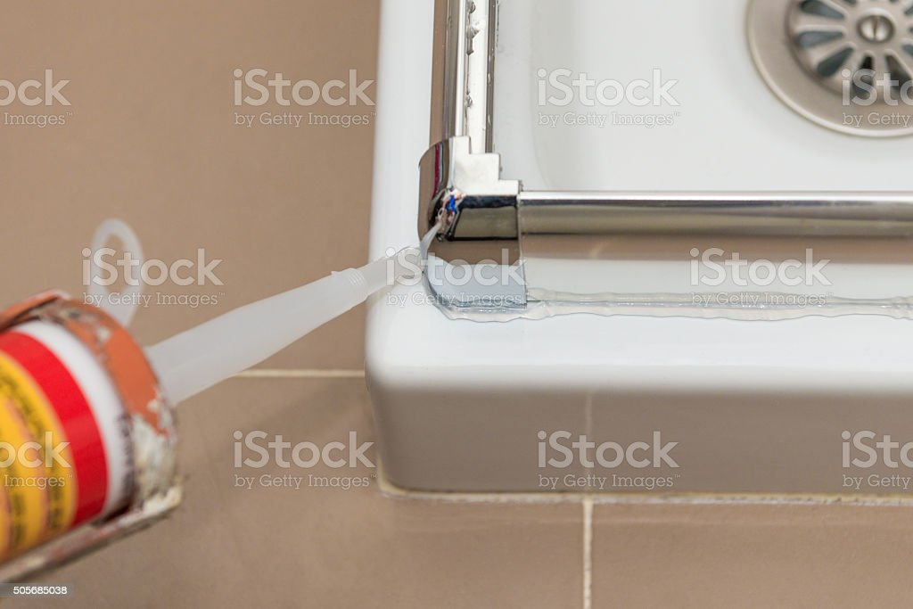 filling silicone for sealing stock photo