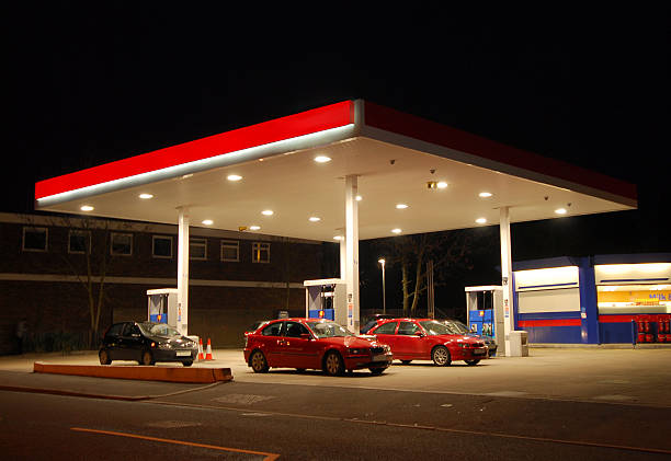 Filling Station at Night, Kent A filling, gas, or petrol station at night, Kent, England canopy stock pictures, royalty-free photos & images