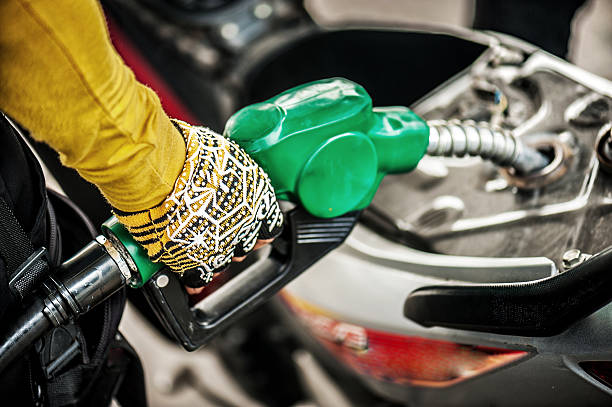 Filling the gas tank with the fuel pump stock photo