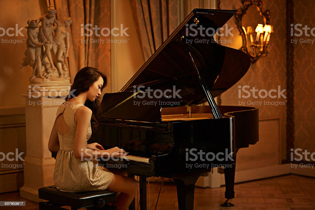Filling the room with beautiful sounds stock photo