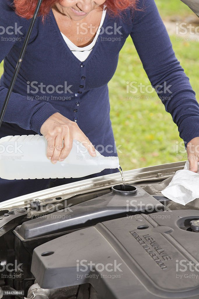 Filling the windshield washer fluid royalty-free stock photo