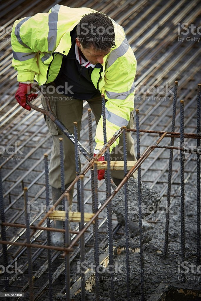 Filling up a foundation block with concrete royalty-free stock photo