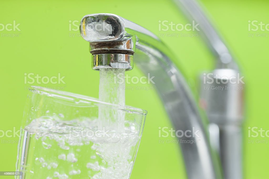 filling up a glass of water stock photo