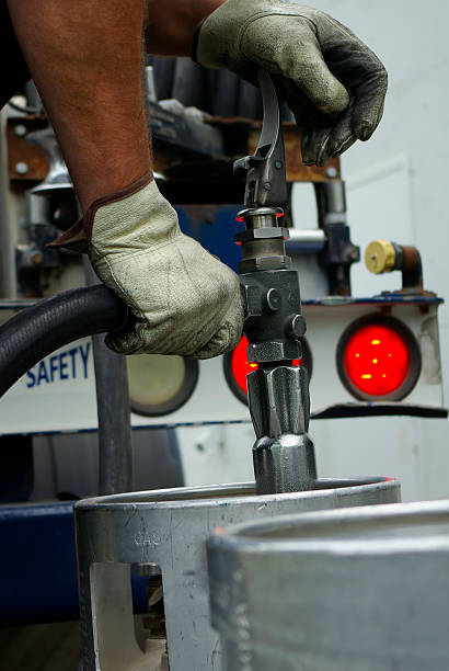 filling up natural gas canisters - mikefahl stock pictures, royalty-free photos & images
