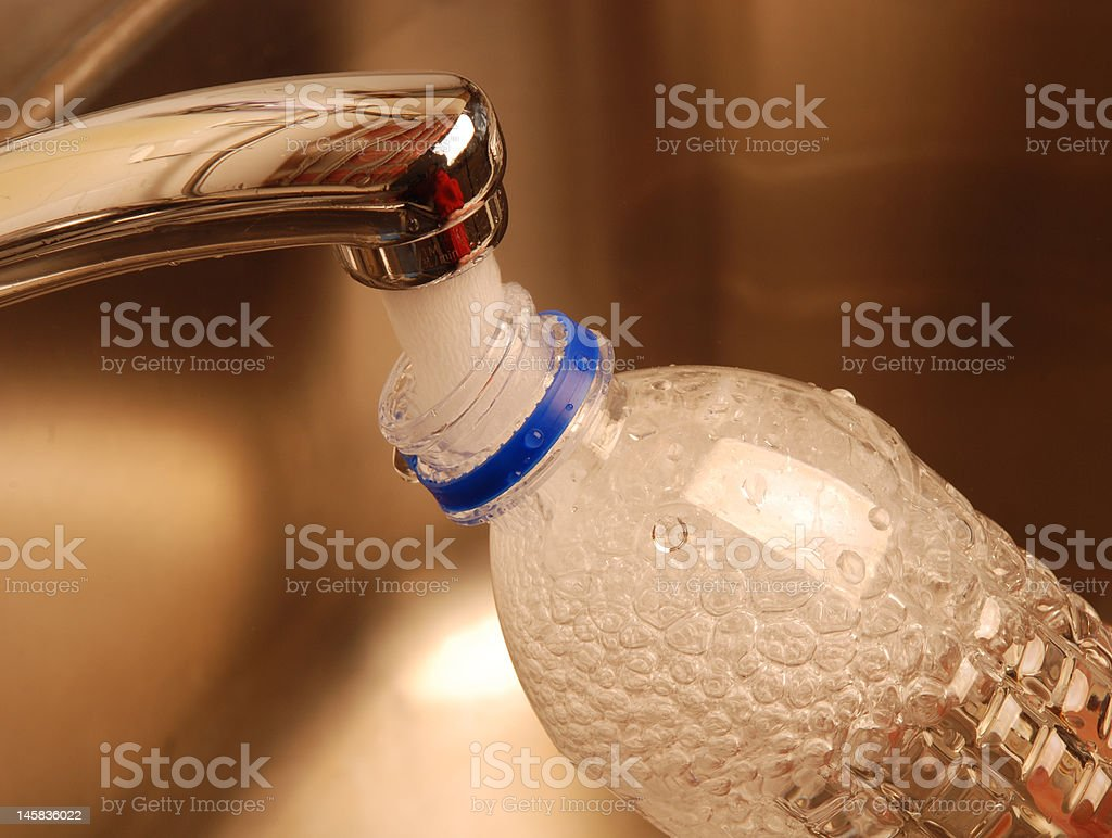 Filling Water Bottle from the Tap Number One stock photo
