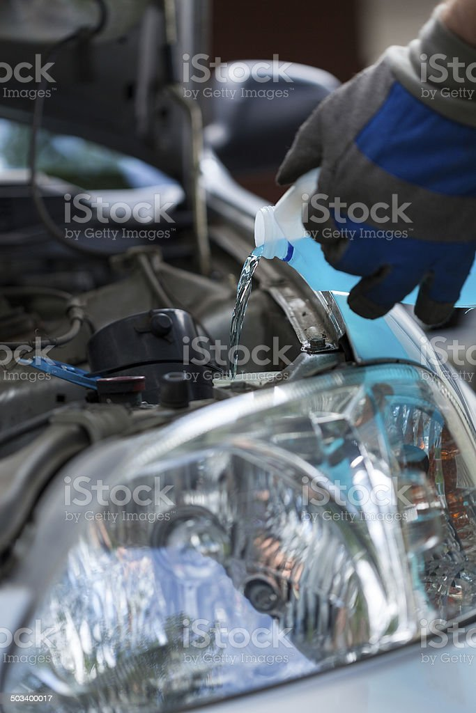 Filling windshield washer fluid stock photo