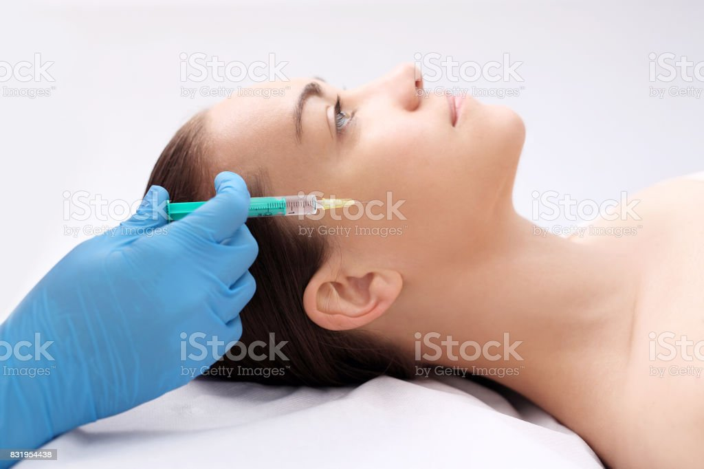 Filling wrinkles, face lift. stock photo