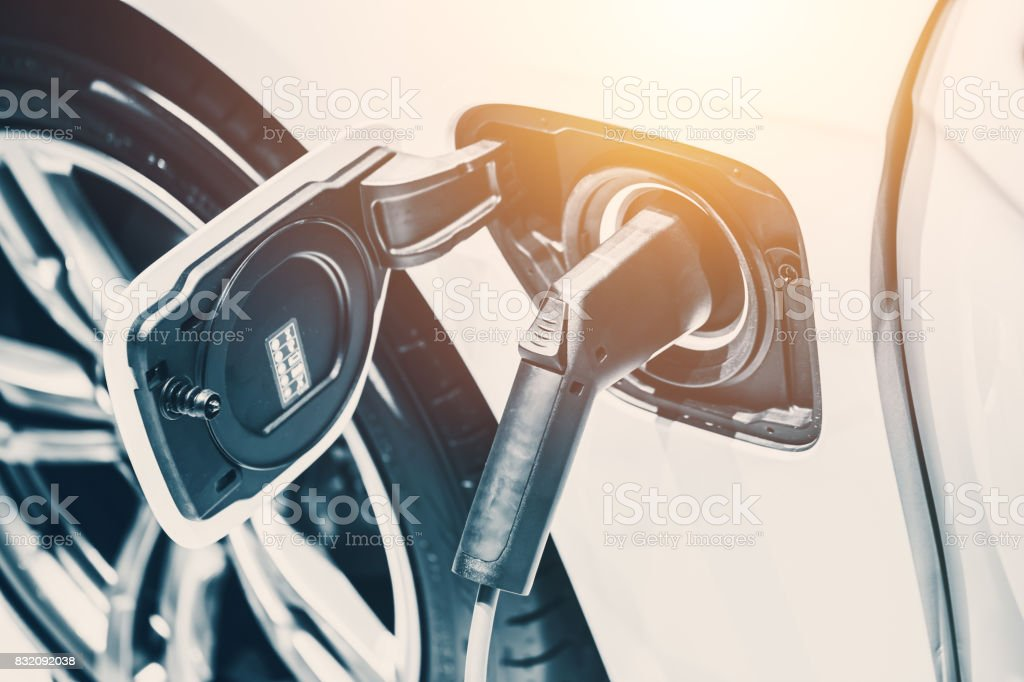 fillup electricity charge battery power electric car. future of ecocar clean energy. stock photo