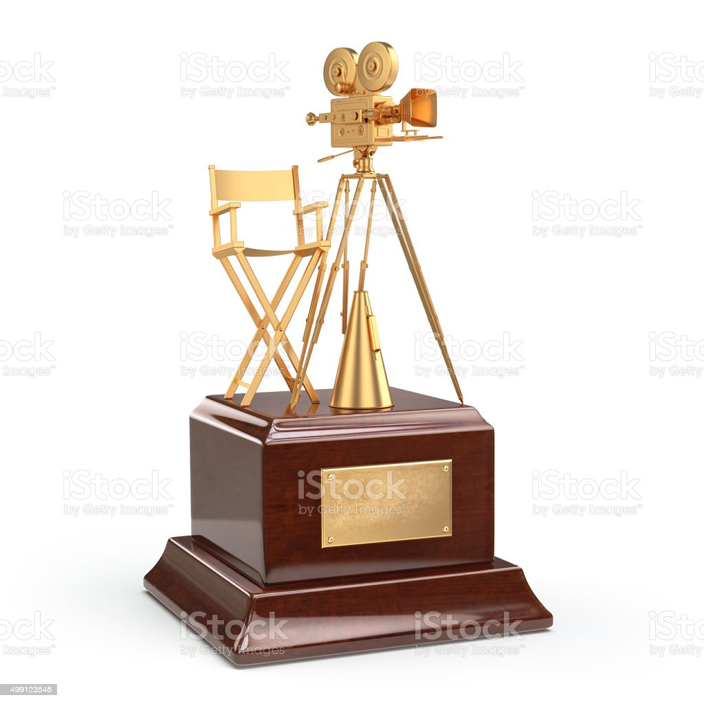 Film award. Gold vintage movie camera and chair of director stock photo