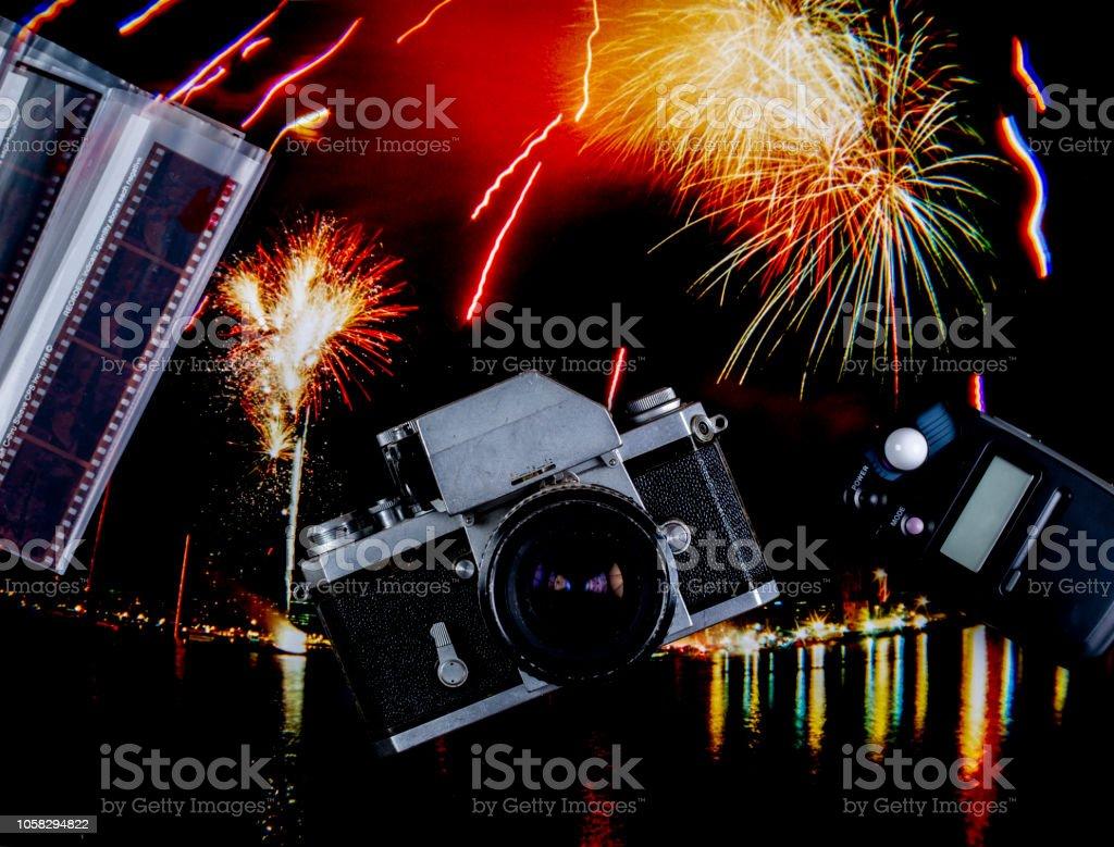 Film Camera Light Meter And Film Negatives On A Fireworks