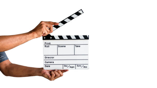 Film Clapboard Slate Hand holding a film clapboard slate or movie slate isolated on white background, with clipping path. performing arts event stock pictures, royalty-free photos & images