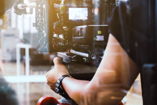 Film crew filming production. cameraman shooting film scene with camera analogue audio storage media stock pictures, royalty-free photos & images