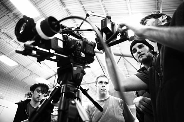 film crew - film director stock pictures, royalty-free photos & images