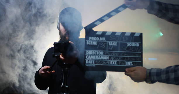 film crew shooting take of scene in studio - film director stock pictures, royalty-free photos & images