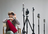 istock Film director behind camera holding lens for testing 180755122