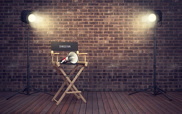 Film director's chair with megaphone and spotlights. 3D renderin – Foto