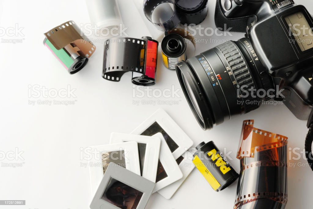 Film equipment including pictures, film strips, and camera stock photo