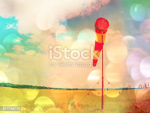 istock Film grain. Summer hot day on sport airport with abandoned windsock, wind is blowing and windsock is moving 817704770
