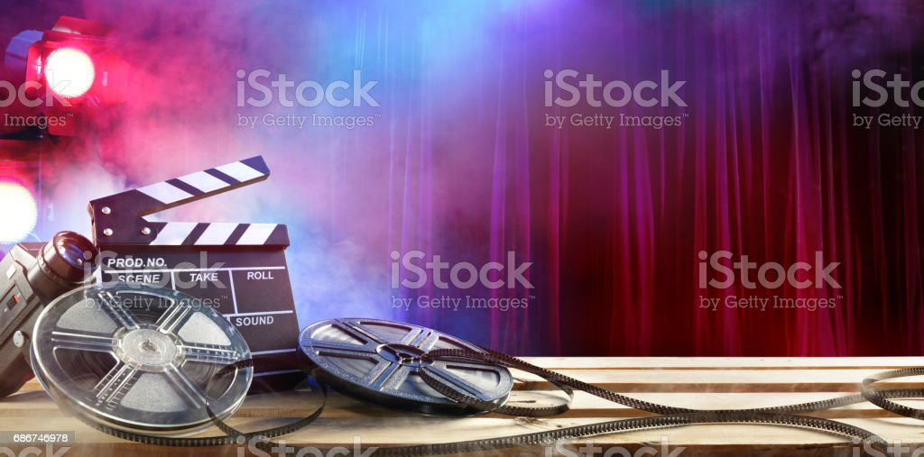 Film movie Background - Clapperboard And Film Reels In Theatre stock photo