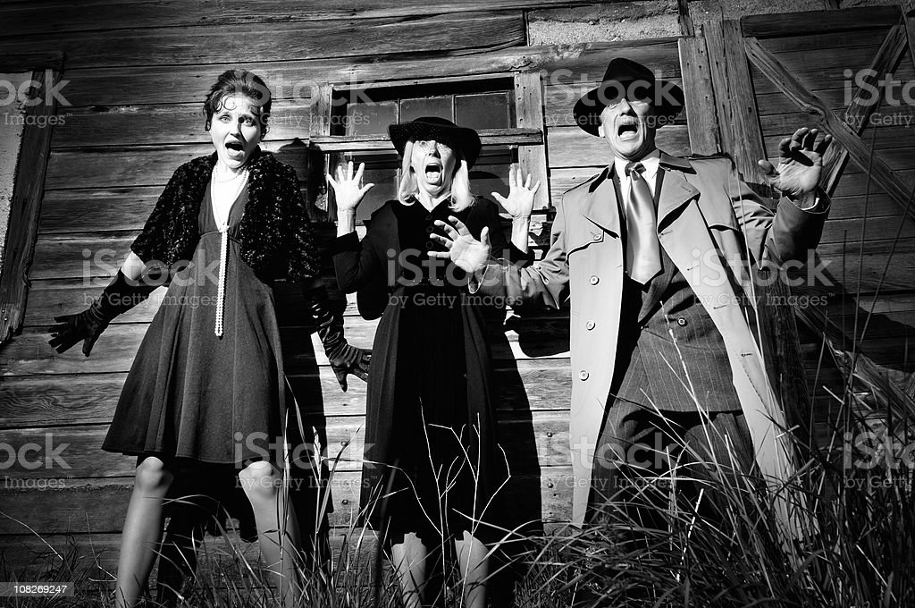 Film Noir Classic Horror of Scared Women and Man stock photo