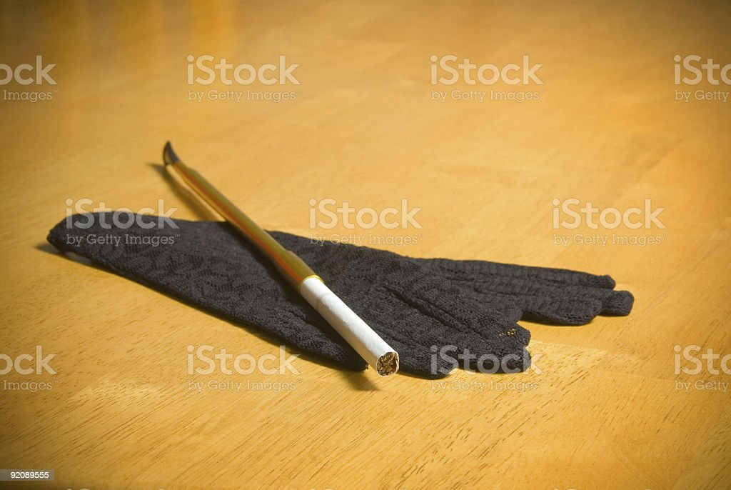 Film Noir style - pair of gloves and cigarette stock photo