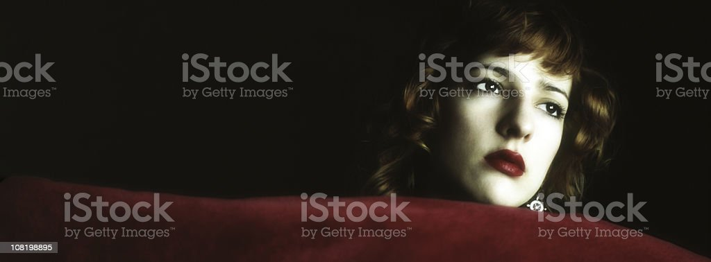 Film Noir Style Woman Leaning on Red Velvet royalty-free stock photo