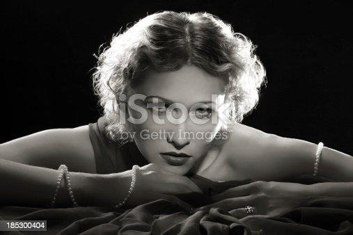 istock Film Noir Style.Diva with necklace 185300404