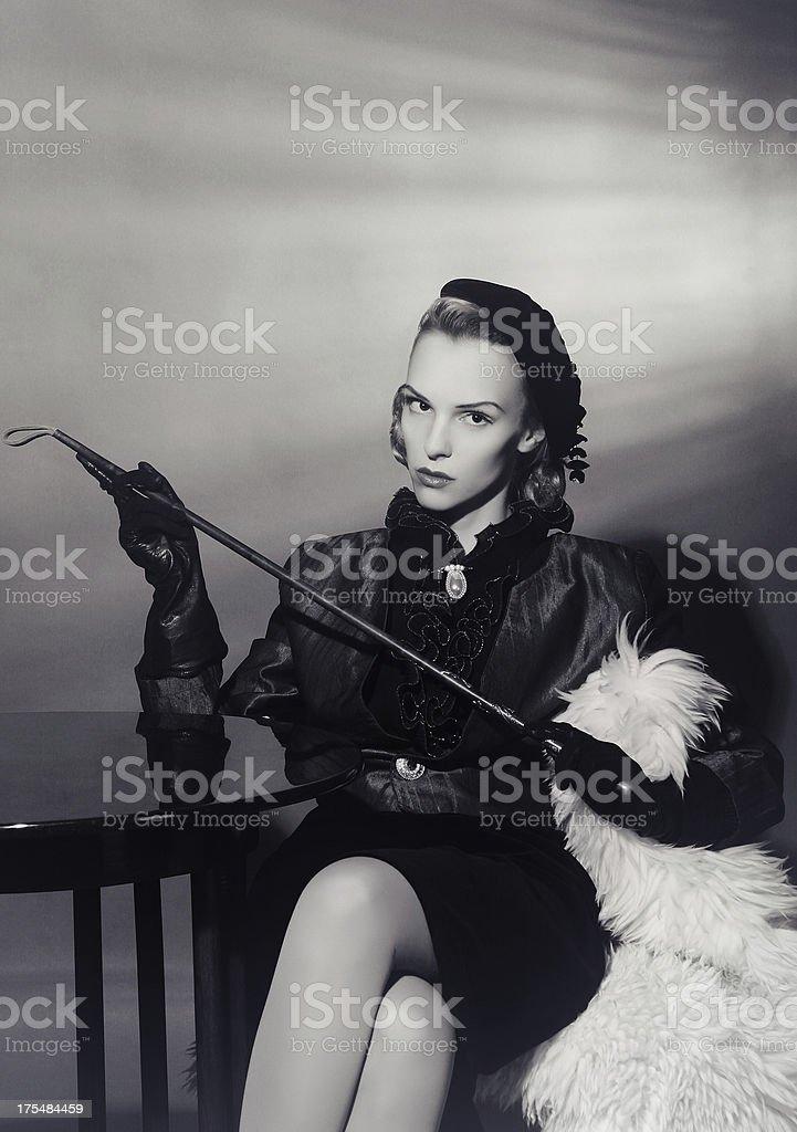 Film Noir Style.Dominatrix stock photo