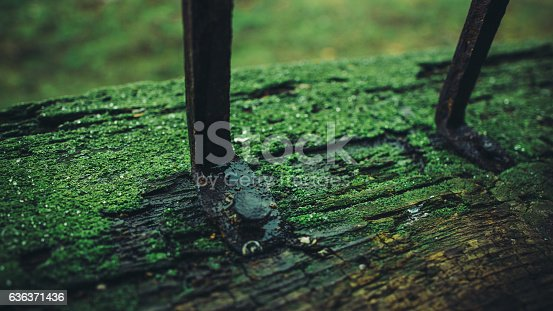 istock Film photos iron rod driven old wooden frame close-up 636371436