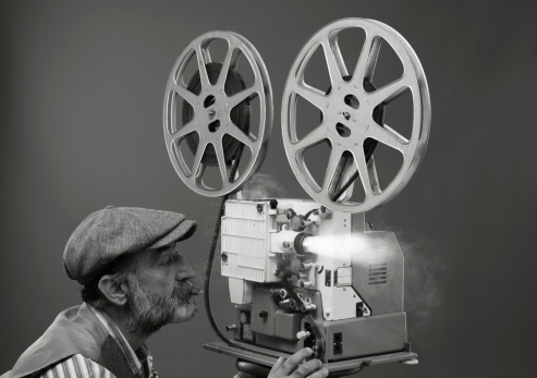 Film projectionist starting movie