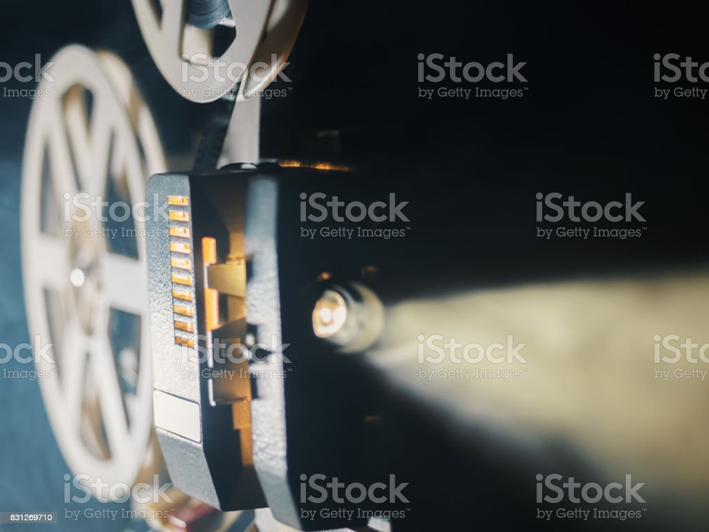 film projector on a black background with dramatic lighting and selective focus stock photo