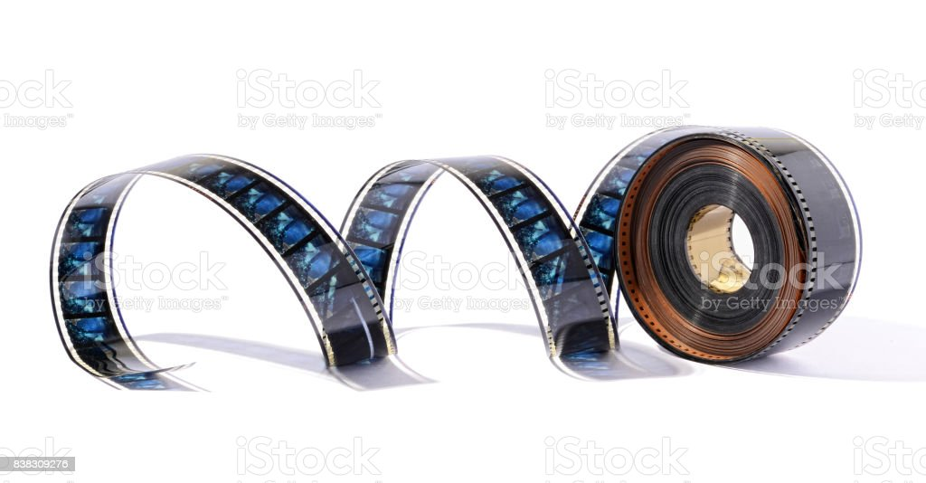 Film reel stretched against white background - foto stock