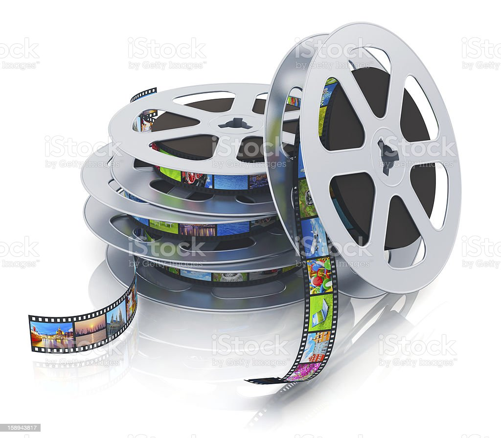Film reels with filmstrips royalty-free stock photo