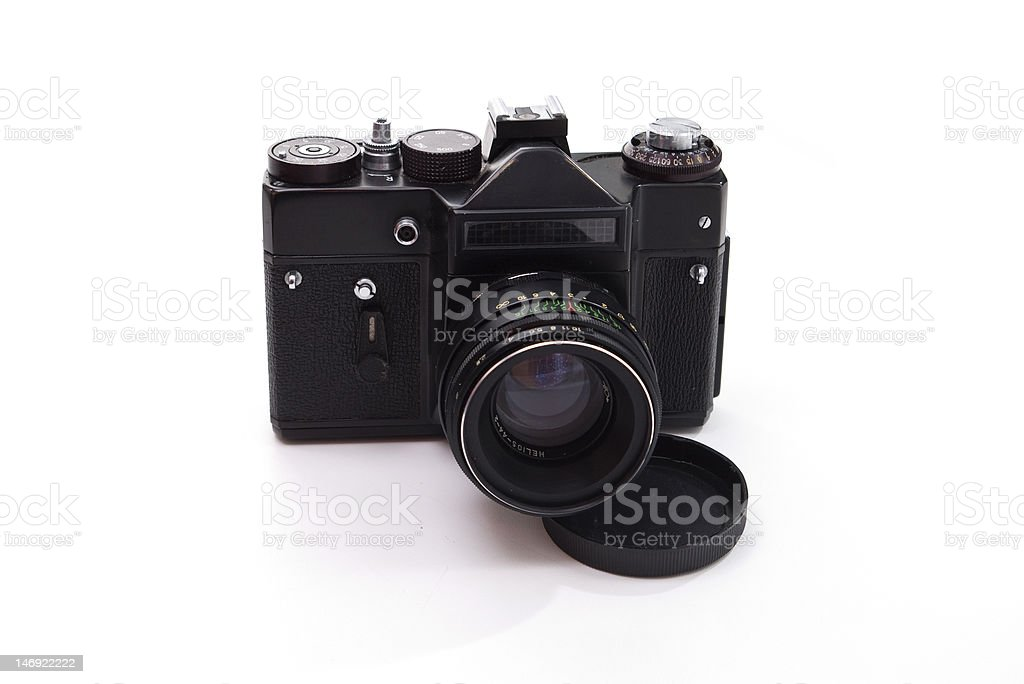 film reflex camera An old film reflex camera isolated on white Camera - Photographic Equipment Stock Photo