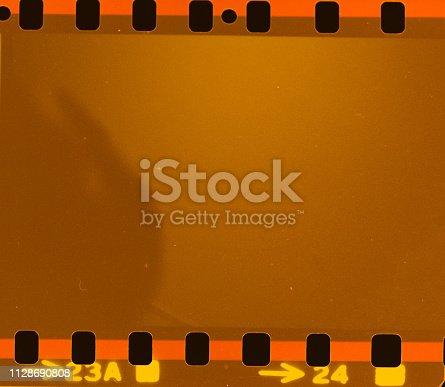 1152194399 istock photo Film strip texture background 1128690808