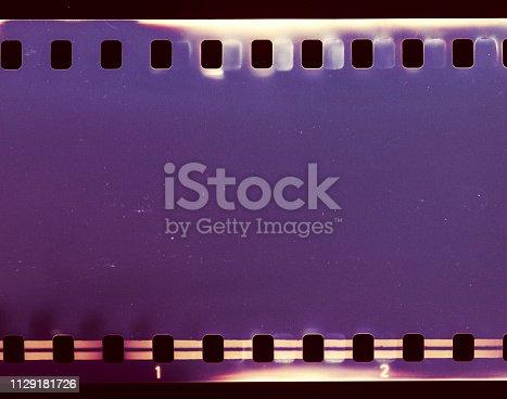1152194399 istock photo Film strip texture background 1129181726