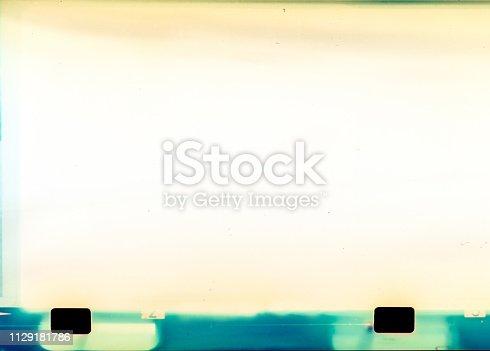 1152194399 istock photo Film strip texture background 1129181786