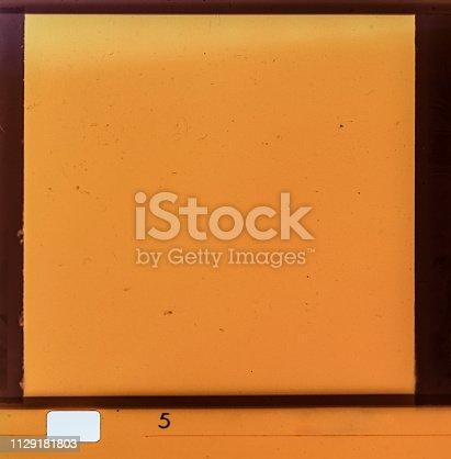 1152194399 istock photo Film strip texture background 1129181803